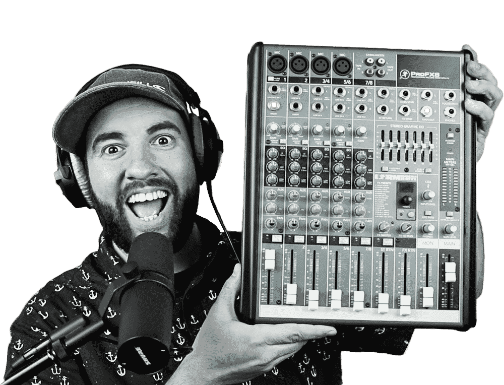 Matt Giovanisci Holding a Mixing Board with Headphones and a Microphone